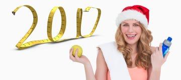 imagen compuesta 3D de la sonrisa rubia del ajuste festivo en la cámara Imágenes de archivo libres de regalías