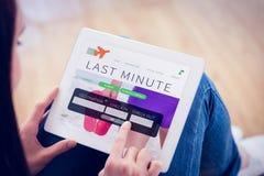 Imagen compuesta de adolescente usando una PC de la tableta que se sienta en el piso Fotos de archivo libres de regalías