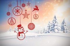 Imagen compuesta de colgar decoraciones rojas de la Navidad Imágenes de archivo libres de regalías