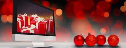 Imagen compuesta de cuatro decoraciones rojas de la bola de la Navidad Fotos de archivo libres de regalías
