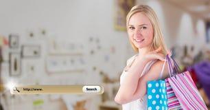 Imagen compuesta de Digitaces de la mujer que sostiene los panieres y la barra de la búsqueda Imagen de archivo