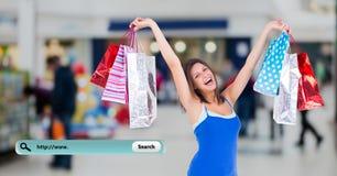 Imagen compuesta de Digitaces de la mujer que sostiene los panieres y la barra de la búsqueda Imagen de archivo libre de regalías