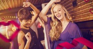 Imagen compuesta de dos mujeres hermosas que bailan en sala de baile Fotografía de archivo libre de regalías