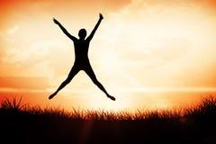 Imagen compuesta de integral de un salto deportivo de la mujer joven Fotografía de archivo libre de regalías