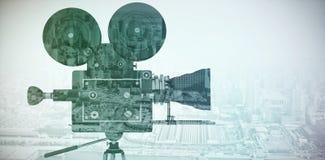Imagen compuesta de la cámara del rollo de película con el trípode Imagen de archivo