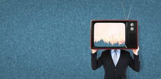 Imagen compuesta de la cabeza de ocultación del hombre de negocios con una caja Fotografía de archivo libre de regalías
