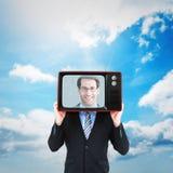 Imagen compuesta de la cabeza de ocultación del hombre de negocios con una caja Imagen de archivo libre de regalías