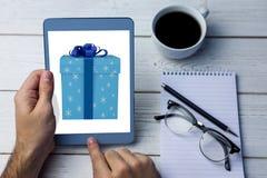 Imagen compuesta de la caja de regalo del azul y de la plata Fotos de archivo