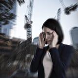 Imagen compuesta de la empresaria que sufre de dolor de cabeza Imagen de archivo