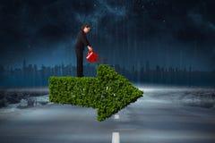 Imagen compuesta de la empresaria que usa la regadera roja Foto de archivo libre de regalías
