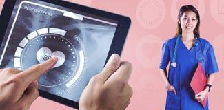 Imagen compuesta de la enfermera asiática con el estetoscopio que mira la cámara Fotografía de archivo libre de regalías