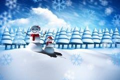 Imagen compuesta de la familia del hombre de la nieve Fotos de archivo libres de regalías