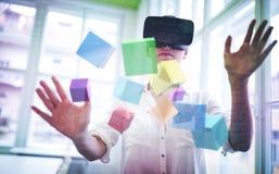 Imagen compuesta de la flotación colorida de los cubos 3d Foto de archivo libre de regalías