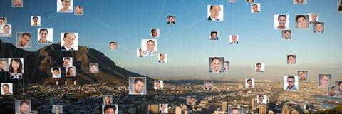 Imagen compuesta de la imagen compuesta de hombres de negocios conectados foto de archivo libre de regalías