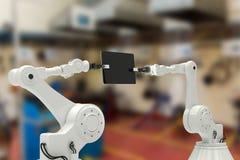 Imagen compuesta de la imagen compuesta de los robots que sostienen la tableta 3d del ordenador Foto de archivo