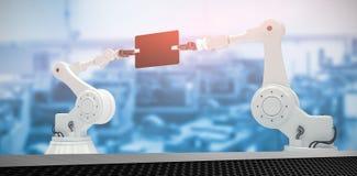 Imagen compuesta de la imagen compuesta de los robots que sostienen la tableta digital 3d Foto de archivo