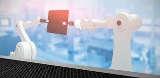 Imagen compuesta de la imagen compuesta digital de robots y de la tableta digital 3d Fotografía de archivo