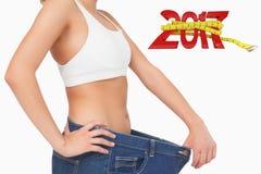 Imagen compuesta de la imagen digital generada del Año Nuevo con cinta métrica imagenes de archivo
