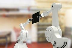 Imagen compuesta de la imagen gráfica de robots con la tableta 3d del ordenador Foto de archivo libre de regalías
