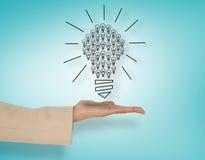 Imagen compuesta de la mano femenina que presenta bombillas Imágenes de archivo libres de regalías