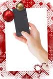 Imagen compuesta de la mano femenina que sostiene un smartphone Imagenes de archivo