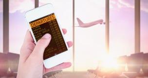 Imagen compuesta de la mano que muestra smartphone Foto de archivo libre de regalías