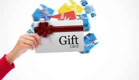 Imagen compuesta de la mano que sostiene la tarjeta Fotografía de archivo libre de regalías