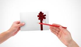 Imagen compuesta de la mano que sostiene la tarjeta Imagenes de archivo