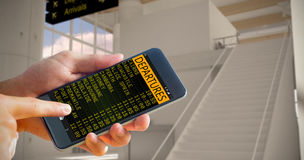 Imagen compuesta de la mano que sostiene smartphone Fotografía de archivo