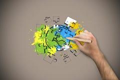 Imagen compuesta de la mano que sostiene un lápiz Imágenes de archivo libres de regalías