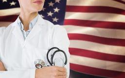 Imagen compuesta de la mediados de sección de un doctor de sexo femenino con el estetoscopio en hospital Fotografía de archivo libre de regalías