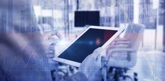 Imagen compuesta de la mediados de sección del hombre de negocios usando la tableta digital Fotos de archivo libres de regalías