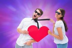 Imagen compuesta de la morenita que tira de su novio por el lazo que lleva a cabo el corazón Imagen de archivo