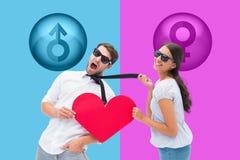 Imagen compuesta de la morenita que tira de su novio por el lazo que lleva a cabo el corazón Foto de archivo