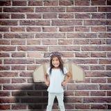 Imagen compuesta de la muchacha derecha con las alas falsas que finge ser piloto fotos de archivo libres de regalías