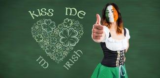 Imagen compuesta de la muchacha irlandesa que muestra los pulgares para arriba Fotos de archivo libres de regalías