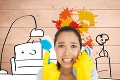 Imagen compuesta de la mujer apenada que sostiene el paño y el cepillo de limpieza Fotografía de archivo libre de regalías
