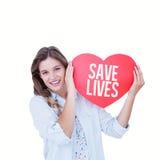 Imagen compuesta de la mujer que sostiene la tarjeta del corazón Foto de archivo libre de regalías