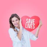 Imagen compuesta de la mujer que sostiene la tarjeta del corazón Fotos de archivo