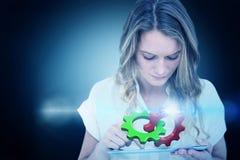 Imagen compuesta de la mujer que usa la PC de la tableta Fotografía de archivo