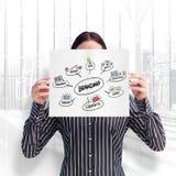 Imagen compuesta de la mujer sonriente que muestra una tarjeta del gran negocio delante de su cara Imagen de archivo