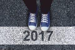 Imagen compuesta de la opinión de alto ángulo de los zapatos de lona de la persona que llevan Foto de archivo libre de regalías