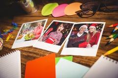 Imagen compuesta de la opinión de alto ángulo de materiales de oficina y de fotos inmediatas en blanco Foto de archivo libre de regalías