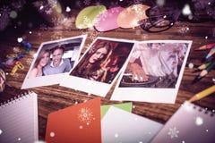 Imagen compuesta de la opinión de alto ángulo de materiales de oficina y de fotos inmediatas en blanco Imagen de archivo