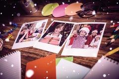 Imagen compuesta de la opinión de alto ángulo de materiales de oficina y de fotos inmediatas en blanco Imágenes de archivo libres de regalías