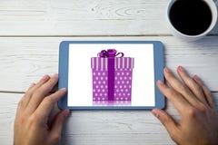 Imagen compuesta de la púrpura y de la caja de regalo de la plata Imágenes de archivo libres de regalías