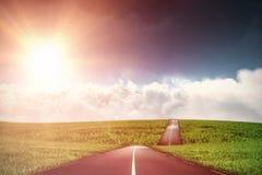 Imagen compuesta de la vista escénica del sol brillante sobre el cloudscape blanco Foto de archivo libre de regalías
