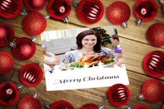 Imagen compuesta de las chucherías de la Navidad en la tabla foto de archivo