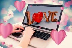 Imagen compuesta de las manos que mecanografían en el ordenador portátil Fotografía de archivo libre de regalías
