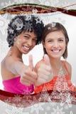 Imagen compuesta de los adolescentes sonrientes que muestran orgulloso sus pulgares para arriba contra un fondo blanco Imagen de archivo libre de regalías